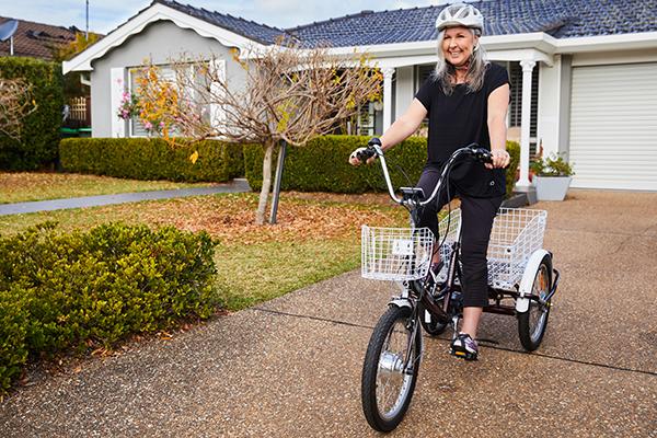 Mature female riding a trike