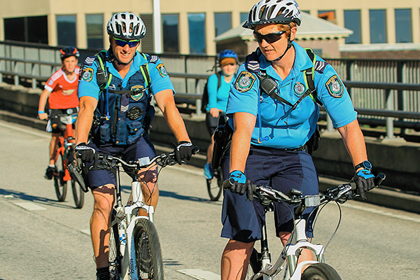 Police cyclists on road