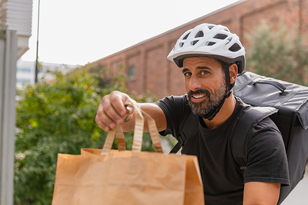 Bike food delivery worker with meal