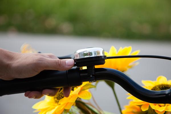 A women ringing her bike bell