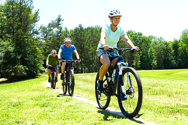 Bike Riders Cycling Within COVID-19 Guidelines