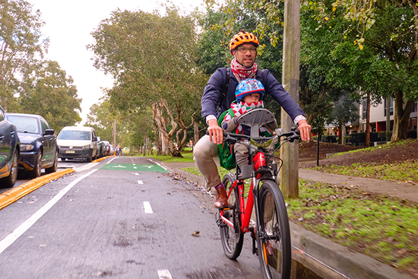 Family riding on pop-up cycleway