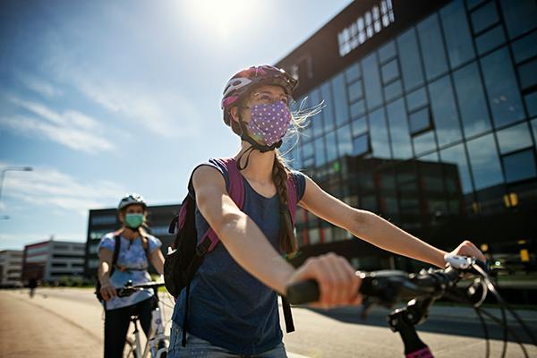 Bike riders wearing face masks