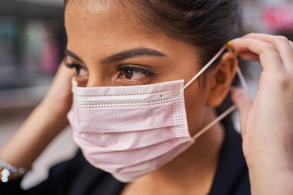 Women putting on mask