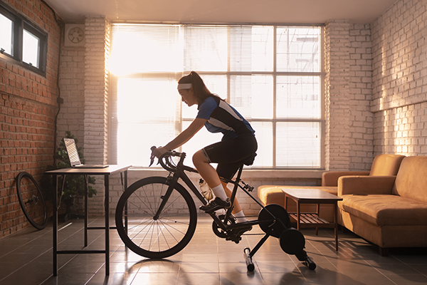 Women riding indoors on a bike trainer