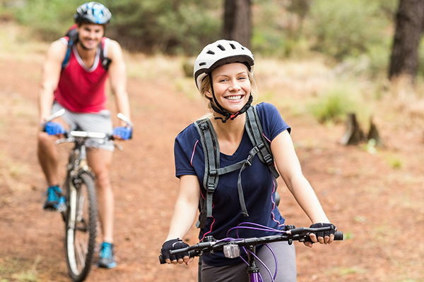Male and female mountain bike rider smiling