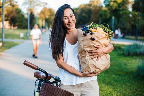 Women holding groceries