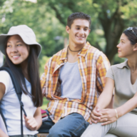 A group of 3 teenagers gathered outdoors