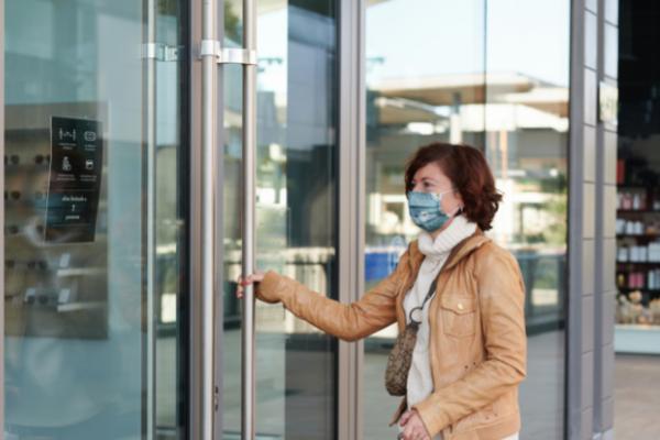Lady wearing mask while entering foyer