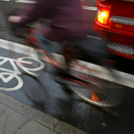 Heavy vehicle passing bicycle rider