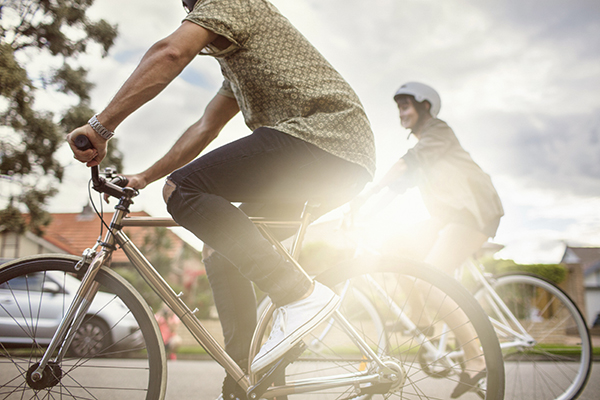 young couple cycling in a Sydney Suburban street