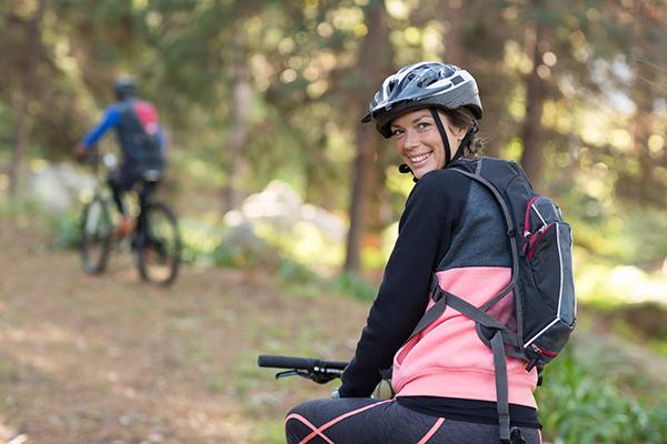 Happy female rider looking back over shoulder