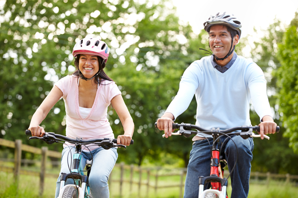 young couple casually bike riding
